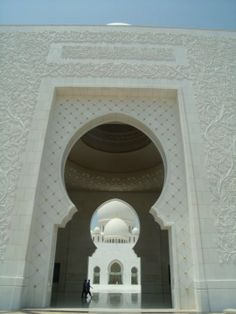 """Close up of the raised carvings on the wall, """"white on white"""" delicate patterns."""