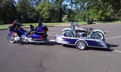 goldwing towing a bike on a trailer