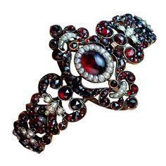 Antique Victorian Era Garnet Bracelet | From a unique collection of vintage bangles at https://www.1stdibs.com/jewelry/bracelets/bangles/