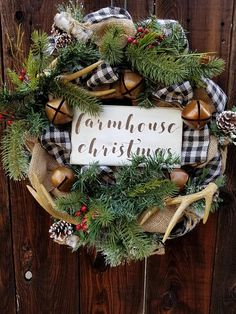 Farmhouse Christmas wreath decorated with antlers, gingham and bells. #affiliatelink #christmas #farmhouse #rustic