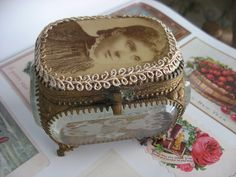 Antique glass jewelry casket with antique CDV photo and trim added to top.