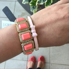 "J crew bracelet TRADES️️. Vintage style blinged out bracelet. Setting is gold tone w/faux clear stones all around. Center stones are coral color. The bracelet stretches to fit most wrists. Approx measurements 6.5"" around from inside.  With of bracelet .75"" J. Crew Jewelry Bracelets"