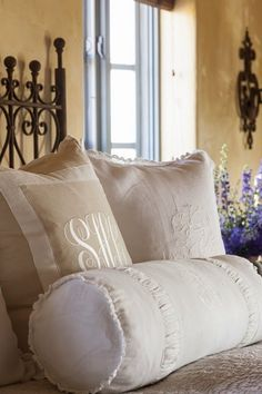 Monogrammed linen pillows in master bedroom of Cindy Hattersley, Rough Luxe Lifestyle
