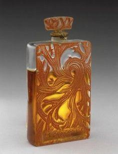 One of the first modern perfume bottles designed by Lalique in the 1920s Fragrantica
