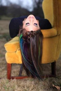 Dark brown hair with green and blue highlights! that is so cool! but i'm not dying my red hair!!