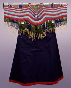 Nez Perce Indian Dress, ca. 1890, wool cloth, leather fringe, glass beads, metal beads, shell beads, and abalone shell, The Elizabeth Cole Butler Collection.
