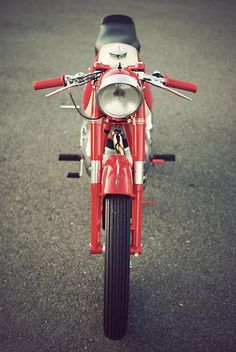 Red motorcycle-- JUST like my old moped-- Only in better condition.