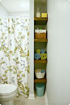 #DIY wood floating shelves for the #basement #bathroom helps optimize space!