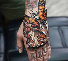 3 colors neotraditional tattoo style of Skull and Moth motive done by tattoo artist A.d. Pancho