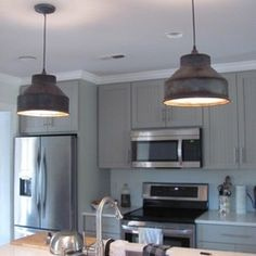 My favorite farmhouse style kitchen pendant lights for under 200 these milk can strainer pendant lights were purchased by a couple who pendant lights for kitchenfarmhouse pendant aloadofball Choice Image