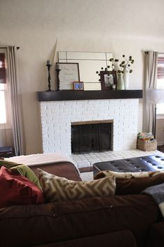 Love the simple mantel and brick facing. A set of electric fireplace logs would look great here.