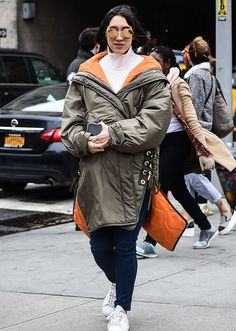Browse the best street style looks from NYFW Fall 2017 via @STYLECASTER | Eva Chen in cargo, tie-up puffer coat