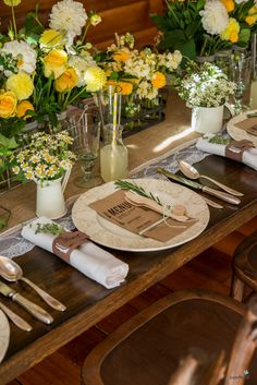 Rustic wedding theme | Rustic table decor set up ideas | Wooden cutlery set tied with string | Confetti.co.uk