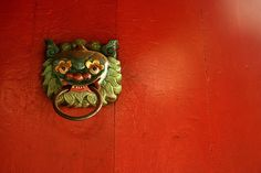 Orange-red door in Tam Son Hoi Quan in Cholon, Saigon