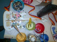 School of Rock: paint and decorate your own guitar with strap!