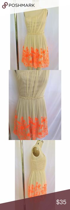 Nude One Shoulder Dress with Neon Embroidery •cream colored one shoulder dress with neon orange floral embroidery •fully lined with mesh overlay •elastic waist Dresses One Shoulder