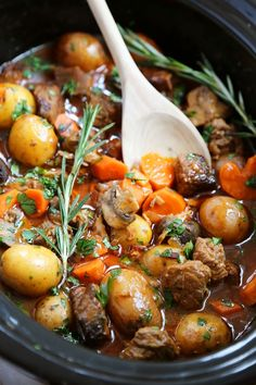 Slow Cooker Beef Bourguignon - Hearty veggies meet juicy, tender beef in this classic French stew. Thecomfortofcooking.com @hollandhousecw #ad