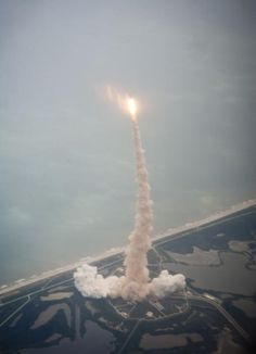 The final launch of Space Shuttle Atlantis as seen through the window of a Shuttle Training Aircraft.