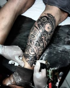 Amazing Black And Grey Biomechanical Tattoo With Clock Tattoo Ideas For Leg Tattoo Design Ideas  Link : http://www.ontattoos.com/