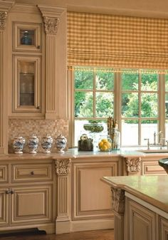 love the mill work and detail of this kitchen.....yellow checks at the windows too....very nice