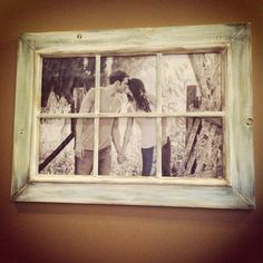 Love the big picture in the old window frame... A little different than just having six separate pictures.