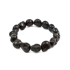 Dainty Black Stretch Skull Bracelet #style #fashion #thealchemyshop #skulls #jewelry #accessories