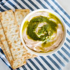 white bean dip with pesto- a healthy, quick and satisfying snack!white bean dip with pesto 2 cups cooked white beans (i used navy beans)  2 medium cloves of garlic  1/4 teaspoon sea salt  1 large lemon  olive oil  pesto to garnish   - place garlic in a food processor and pulse until chopped  - add white beans, sea salt, juice of 1/2 lemon and blend until creamy  - add more salt/lemon juice to taste  - scoop into serving bowl and garnish with pesto and olive oil