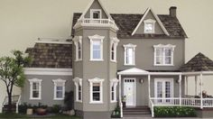 A customized Glenwood Dollhouse with Mansard Addition. Looks awesome. Dollhouse and addition kits by Real Good Toys. #MadeinUSA