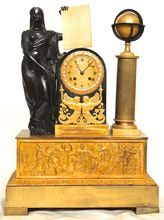 A Restauration ormolu and patinated bronze mantel clock surmounted by a personification of science, circa 1820