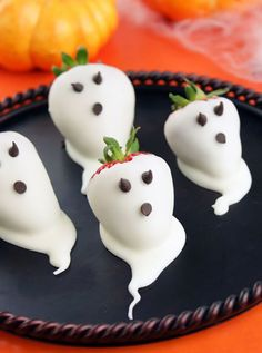 Dip strawberries in white chocolate, then give them chocolate chip eyes + a mouth for these cute + tasty Halloween snacks.