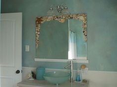 Craft a seashell mirror frame that fits perfectly in a beachy bathroom.