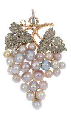 An early 20th century gold seed and cultured pearl grapevine pendant. The seed and cultured pearl stylised grapes, to the textured vine leaves and entwined branch. Length 3.7cms