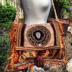 Boho bag like the style. Know how I like upholsteries..... Tassels and Pom poms