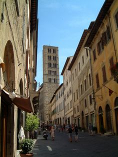 Street and church tower in Arezzo.