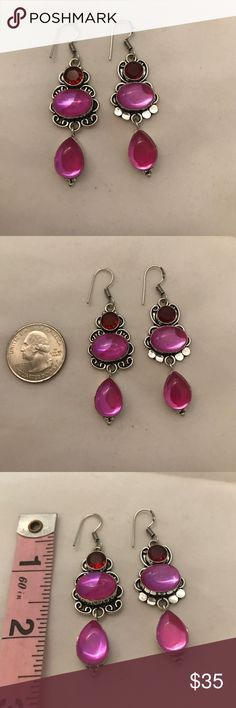 925 sterling silver garnet mystic topaz earrings These beauties are comprised of 💯% 925 sterling silver & stamped 925. Have French hook fasteners that are also stamped 925. Top 💎 stone is a faceted, shiny, 💯% red Garnet, followed by an oval & then tear drop shaped 💯% pink mystic topaz gemstone. Has hand tooled, vintage style silver work around base of gems. Measures 2.5 X 0.5 inches in L X W. All hand made, NWOT lovely earrings 💞❤️️ hand made Jewelry Earrings