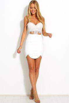 The Love In The Club Dress is a fitted mini sweet with a lovely sweet heart bodice with padding covered in a delicate lace fabric. This style has thin adjustable straps, stretch elastic at back, hidden back zip and small cut outs at stomach. Skirt fits firmly on the body in a thick fabric with stretch. We recommend staying true to size as this is a bodycon style.   Lace mini dress. Not lined. Cold hand wash only. Model is standard XS and wears XS. Thick fabric. True to size. 100% Polyester.