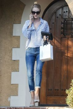 Borrowing from Jason?: Rosie Huntington-Whiteley looked like she had borrowed fiance Jason...