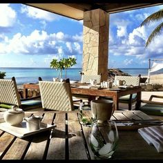 Dine al fresco at Viceroy Riviera Maya with views of the turquoise Caribbean water, steps away from the beach