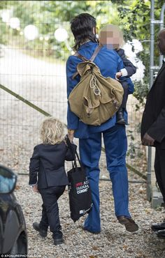 Stylish:Dressed in a quirky three-piece navy suit, the father-of-two, 26, cut a stylish figure as he moved his sadness to one side to enjoy the happy day of his sister-in-law
