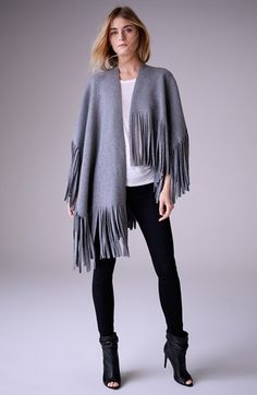 Free shipping and returns on Burberry London Felted Wool & Cashmere Blend Poncho Wrap at Nordstrom.com. Wrap yourself in the sumptuous softness of this effortless piece from Italy in an asymmetrical cut finished with a border of raw-cut fringe.