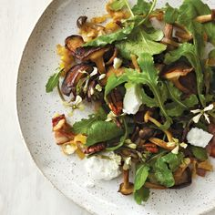 At Farmhaus in St. Louis, 2011 Best New Chef Kevin Willmann makes a delicious garlic oil for this warm mushroom salad then adds bacon and goat cheese.