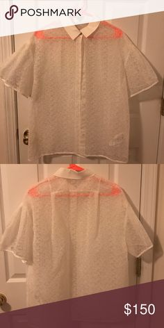 A white oversized Kenzo shirt A barely used white oversized Kenzo shirt! 84% cotton and 16% polyester! Kenzo Tops Button Down Shirts