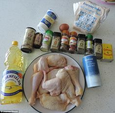 The recipe requires flour, salt, canola oil, buttermilk, egg, white pepper, black pepper, garlic salt, ground ginger, celery salt, paprika, oregano, mustard powder, thyme and basil leaves, as well as a whole chicken, cut into pieces
