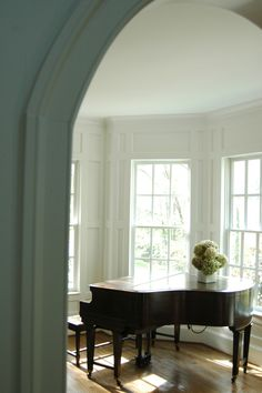 perfection! Light Filled Piano Room- love the arched doorway. We also have a double legged baby grand- this is the only other one I have seen!