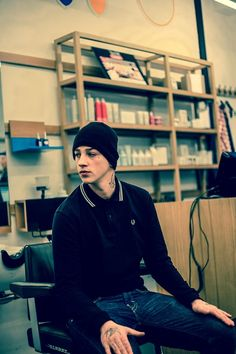 Ash Stymest; casual form, sitting, side view, face, color, clothing, hands