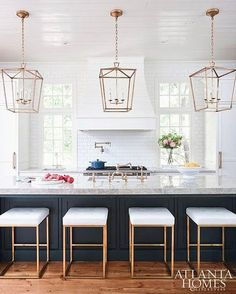 White kitchen with dark blue wainscoted island donning a gray quartzite countertop fitted with a sink paired with a vintage brass faucet lit by Darlana Medium Lanterns hung from a white plank ceiling. Home Decor Kitchen, New Kitchen, Home Kitchens, Kitchen Dining, Kitchen Ideas, Updated Kitchen, 2017 Kitchens, Modern Kitchens, Kitchen Townhouse Ideas