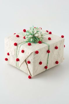 Pompom wrapping paper cute and super easy to do. Need: brown wrapping paper, glue gun, pompoms, and colored ribbon or twine Wrapping Ideas, Creative Gift Wrapping, Present Wrapping, Creative Gifts, All Things Christmas, Christmas Time, Christmas Crafts, White Christmas, Christmas Jesus