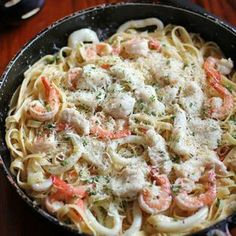 Creamy Seafood Alfredo.............. don't know about the squid though!!