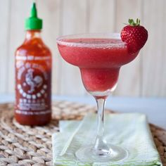 Strawberry Sriracha Margarita 2 cups strawberries, hulled and chopped 1/2 cup tequilla 1/4 cup Cointreau (or other orange flavored liquor) 1 tbs agave nectar 1/2 tsp Sriracha 2 cups ice (yield: 32oz, about 2 generous servings) Instructions Add all ingredients to a blender, blend until smooth. Pour into a sugar rimmed margarita glass.