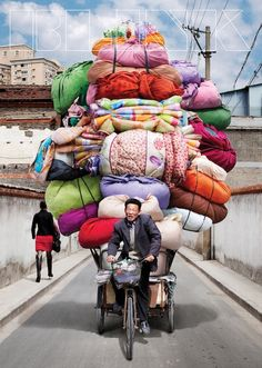 Vietnam is known for its cargo bikes, but these delivery men and women in China make the pedalers of Saigon look like pansies. Photographer Alain Delorme became fascinated with the bike haulers of China In This World, We Are The World, People Around The World, Wonders Of The World, Around The Worlds, Vietnam, Laos, Cargo Bike, Belle Photo